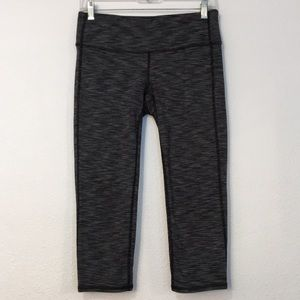 Athelta gray and black crops. Size M